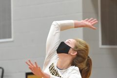 Unionville's (17) Maddy Lowe serves against Council Rock North in the first game of theDistrict 1- 4A  volleyball finals at Unionville High School.