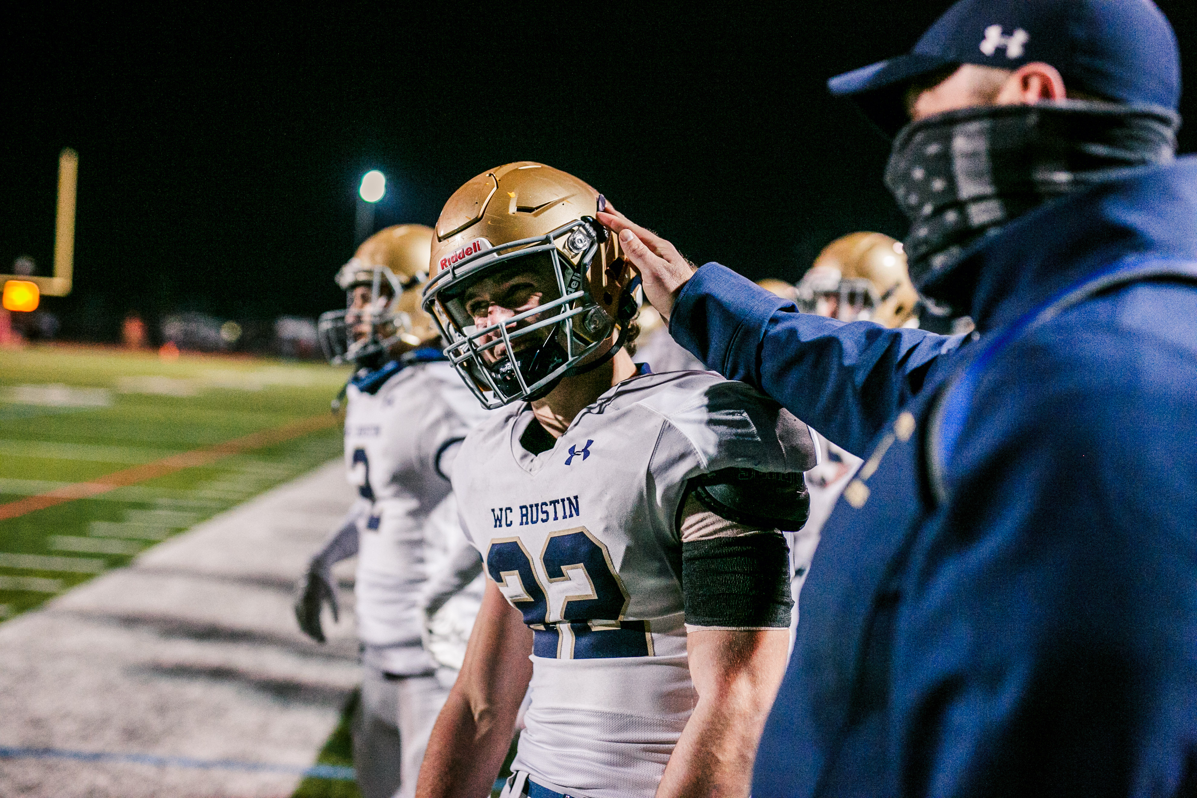 West Chester Rustin's Tucker Flynn gets a pat on the head from assistant coach, John Timko. (Nate Heckenberger - For MediaNews Group)