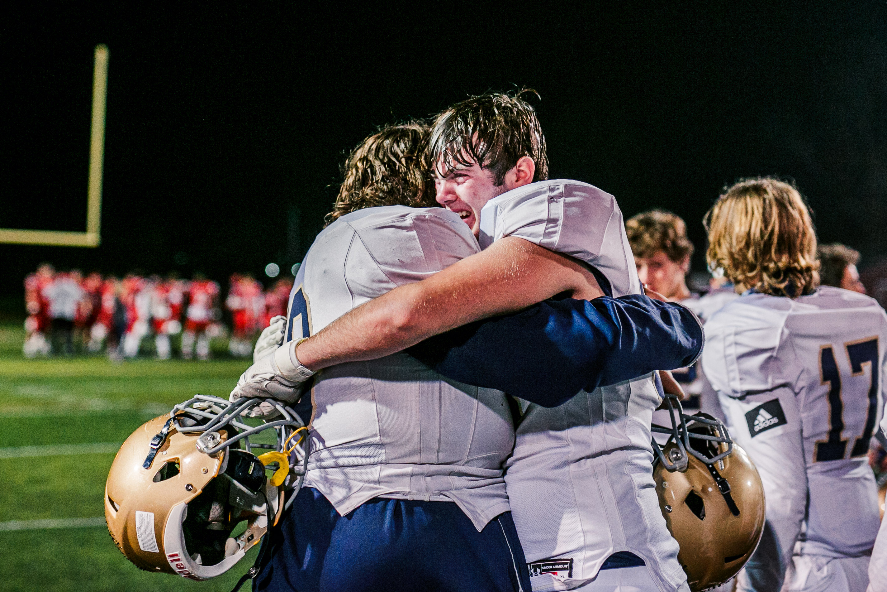 West Chester Rustin's Jack Shoup, right, and Connor McQuiston embrace after the 29-8 loss to Upper Dublin. (Nate Heckenberger - For MediaNews Group)