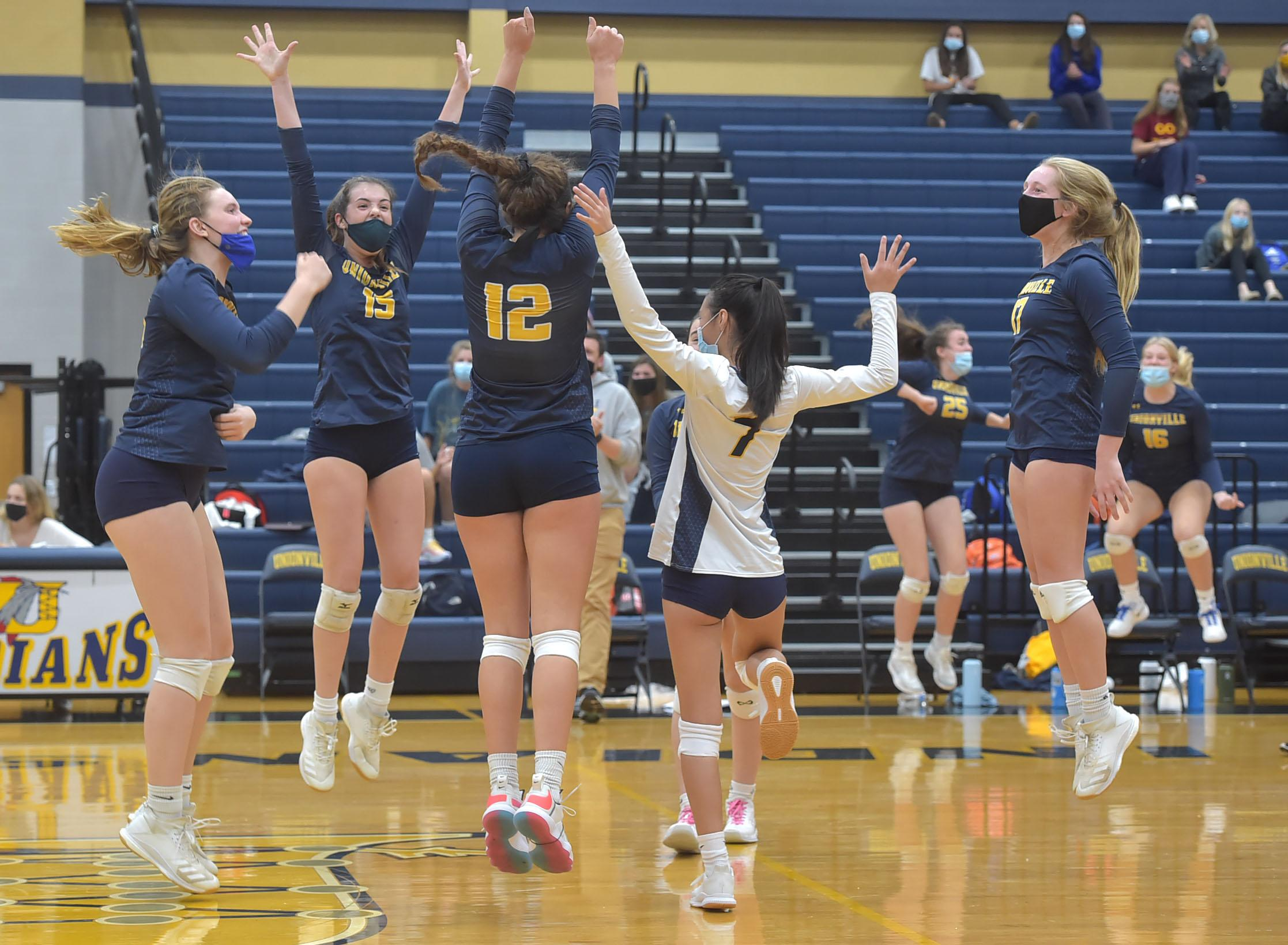 Unionville players celebrate their 3 game to one victory of Bishop Shanahan Wednesday afternnon for the unofficial league title.