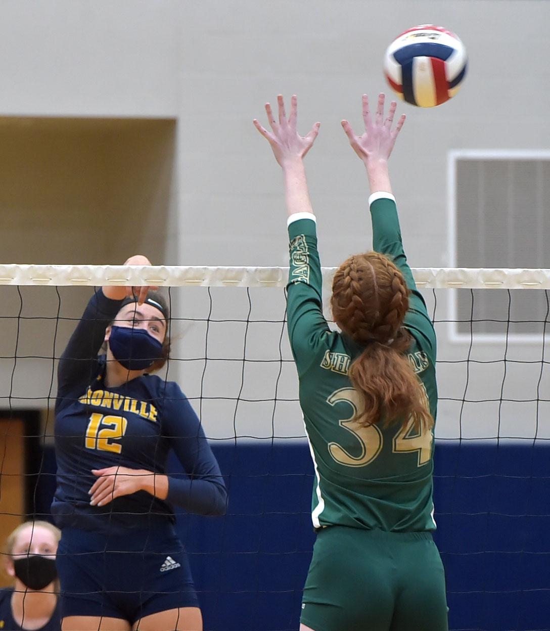 Unionville's (12) Sophie Brenner fires a ball in the decisive fourt game past Bishop Shanahan (34) Bridgette Kelly Wednesday afternoon.