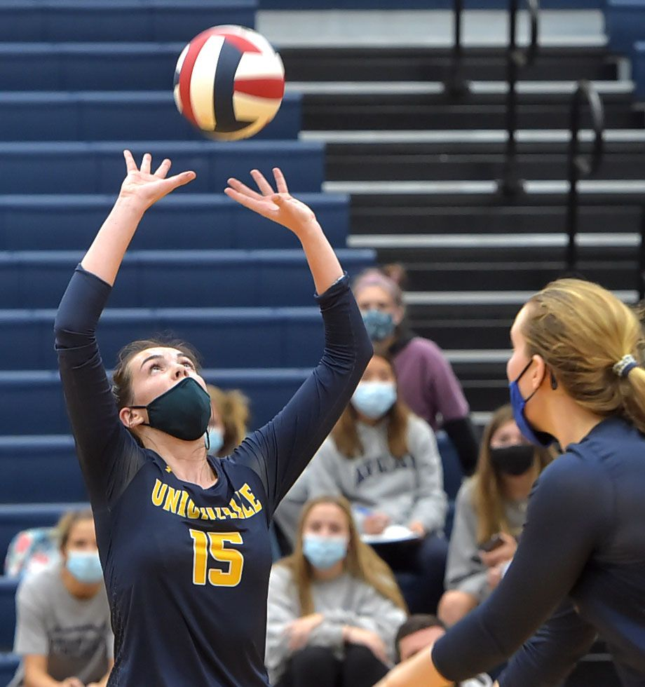 Unionville's (15) Ashlyn Wiswall sets the ball for (28) Genna Weeber in game four game against Bishop Shanahan Wednesday afternoon.